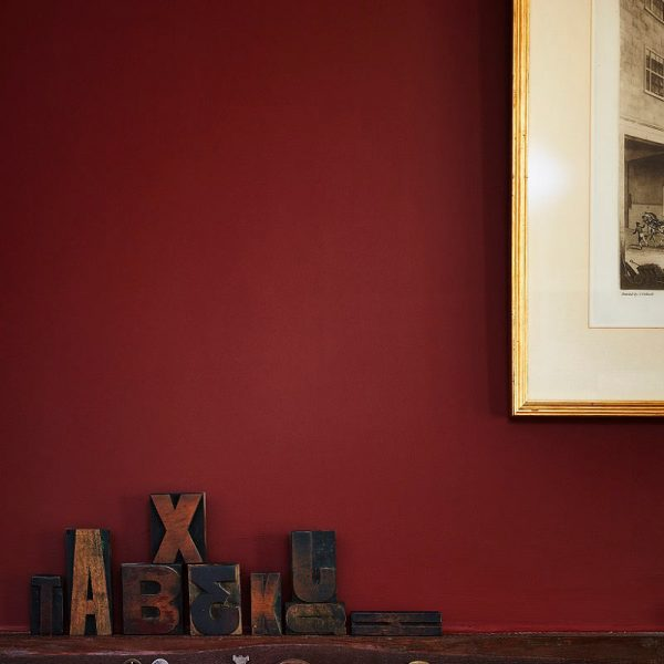 Printpress letters and frame in from of Etruscan Red wall
