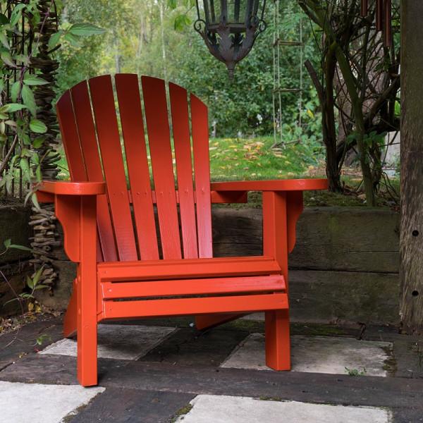 Burnt Orange chair in green garden