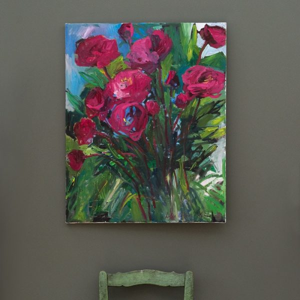 Colourful flower painting in front of Grey Green painted wall