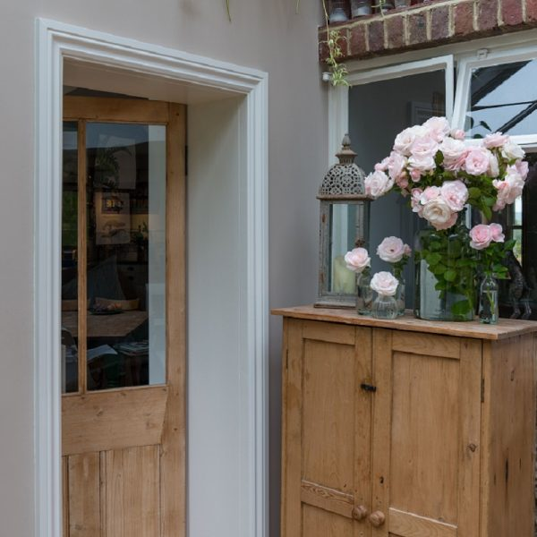 Wooden door and cupboard with accessories