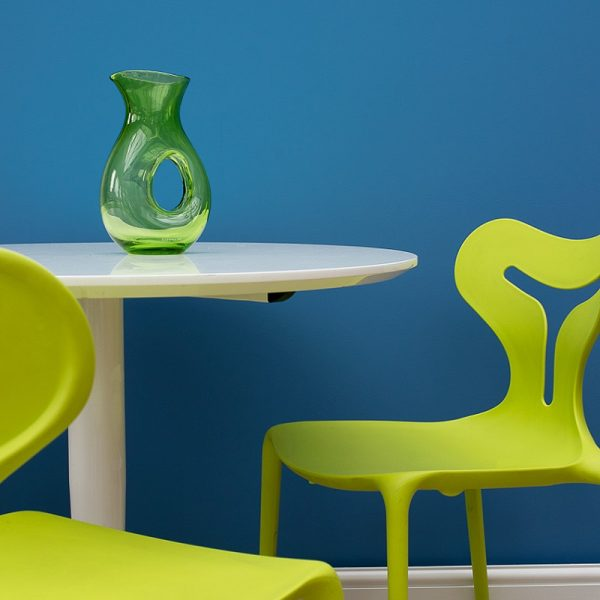 Saxe blue wall with green chairs