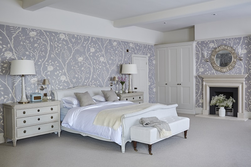 Bedroom designed by Sims Hilditch, floral wallpaper and neutral tones