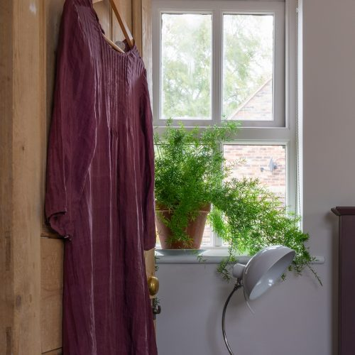White Lilac and Deep Mauve have been used in this bedroom