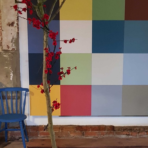 Multi-coloured painted brick wall