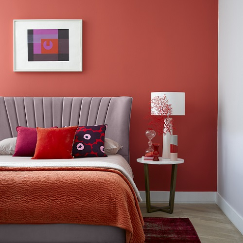 Bedroom feature wall painted in Cinnabar - Furniture Village