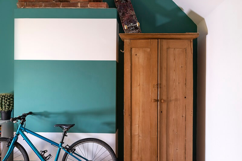 Niblock striped wall with bike in front and cupboard to the right