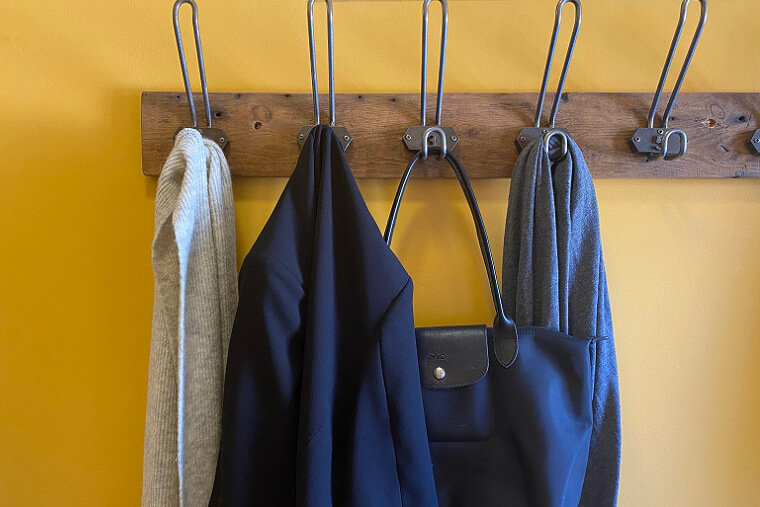 Gladio - a Warm Yellow Wall with coat hooks