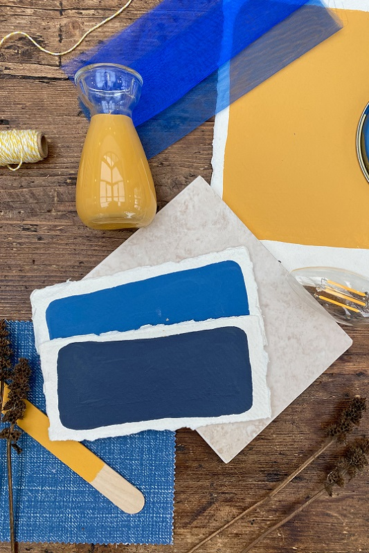 Bold Yellow and Blue moodboard with a floor tile and some fabrics